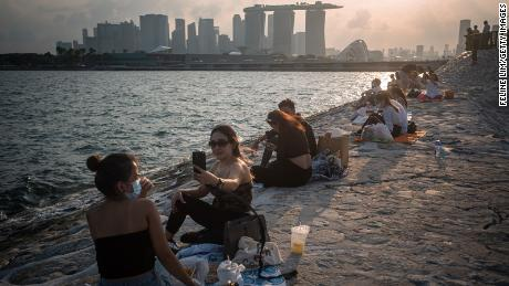 In May, Singapore reduced the number of people who could socialize together from five to two.