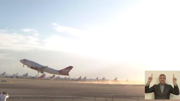 Virgin Orbit's retrofitted Boeing 747 airplane, with a rocket affixed beneath the wing, takes off from California ahead of launch.