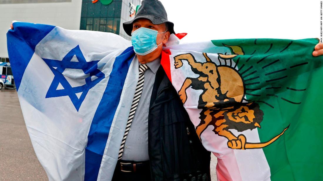 An Israeli man of Iranian descent holds Iran's pre-revolution flag in support of Iranian judoka Saeid Mollaei during the Tel Aviv Grand Slam 2021 on February 19, 2021.