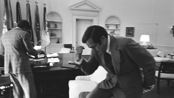 Rumsfeld pumps his fist while working in the White House Oval Office in 1974. Rumsfeld was White House chief of staff before becoming President Gerald Ford's secretary of defense in 1975.