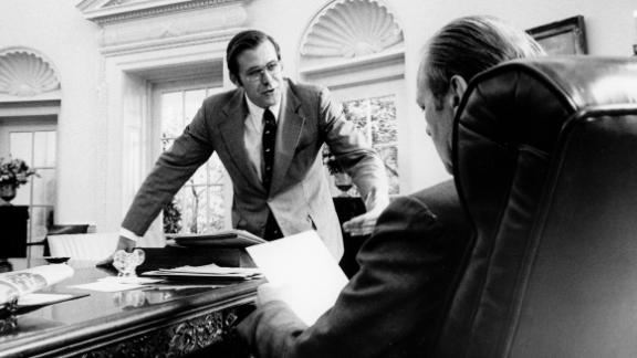 Rumsfeld speaks with Ford in the Oval Office circa 1975.
