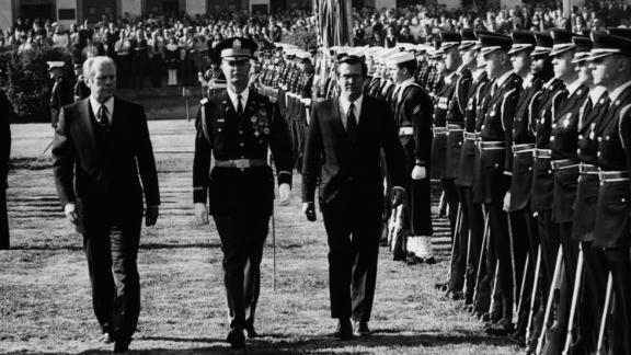Ford and Rumsfeld review a line of troops on the Pentagon lawn in 1975. Rumsfeld, at 43 years old, was the youngest defense secretary in US history when he took the position.