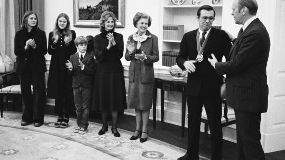 Rumsfeld receives the Presidential Medal of Freedom from Ford in January 1976. Joining them, from left, are Rumsfeld's children, Valerie, Marcy, and Nick; his wife, Joyce; and first lady Betty Ford.