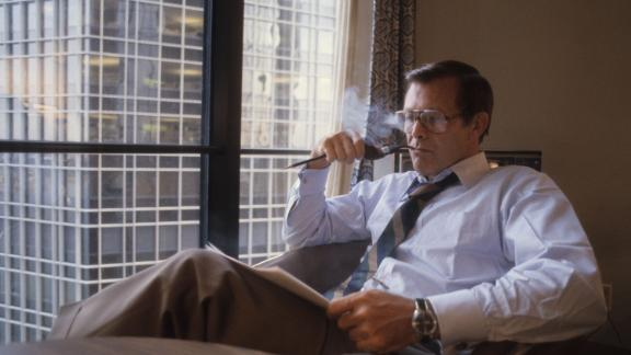 Rumsfeld smoke a pipe while sitting in Ford's suite during the Republican National Convention in 1980.