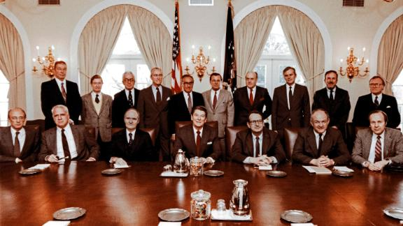 Rumsfeld, standing at center in the light-gray suit, poses with President Ronald Reagan, the President's Commission on Strategic Forces and the special counselors to the commission in 1983.