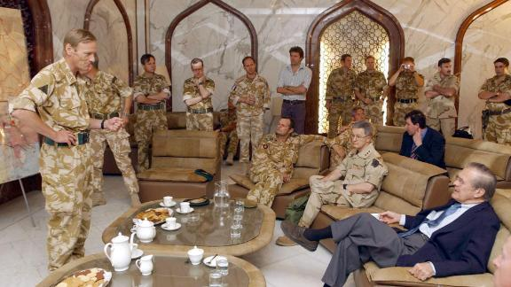 Rumsfeld is briefed by British Major Gen. Robin Brimms, left, at the Basra Airport in Iraq in April 2003.