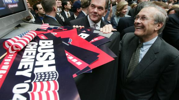 Rumsfeld and Homeland Security Secretary Tom Ridge watch news coverage of the presidential election in November 2004. Bush defeated John Kerry to win re-election.