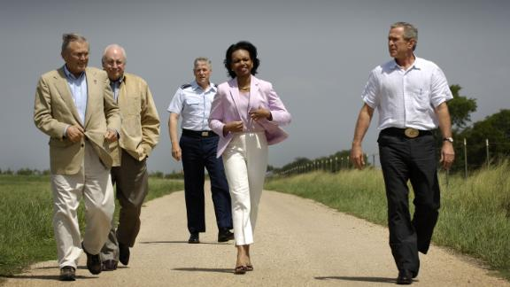 From left, Rumsfeld, Vice President Dick Cheney, Chairman of the Joint Chiefs of Staff Gen. Richard Myers and Secretary of State Condoleezza Rice walk with Bush at the President's ranch in Crawford, Texas, in August 2005.