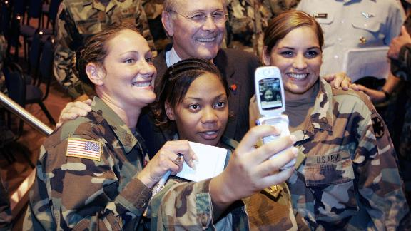 Rumsfeld poses for a photo with US troops during a visit to California's Fort Irwin in August 2005.