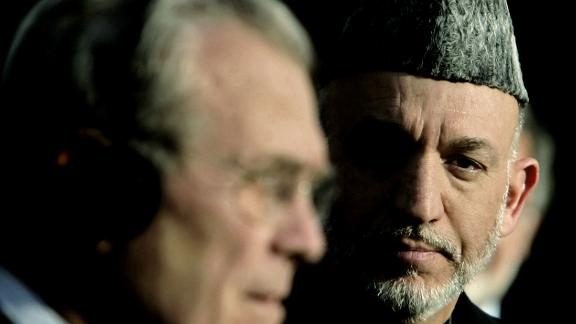 Rumsfeld holds a joint news conference with Afghan President Hamid Karzai in Kabul, Afghanistan, in December 2005. Rumsfeld told reporters that the United States was not going to abandon Afghanistan.