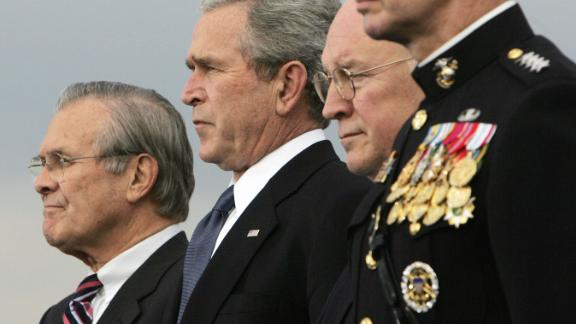 Rumsfeld, left, joins Bush, Cheney and Chairman of the Joint Chiefs of Staff Gen. Peter Pace for a Pentagon ceremony in December 2006. Bush was replacing Rumsfeld as secretary of defense.