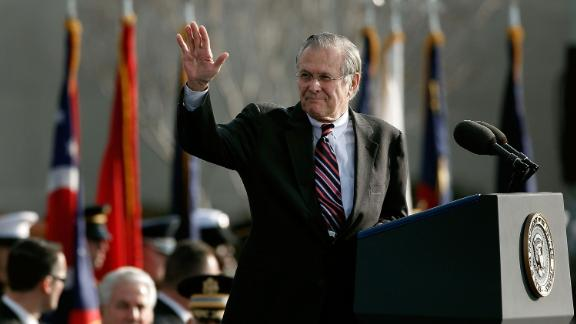 Rumsfeld waves after making remarks at his retirement ceremony in December 2006.