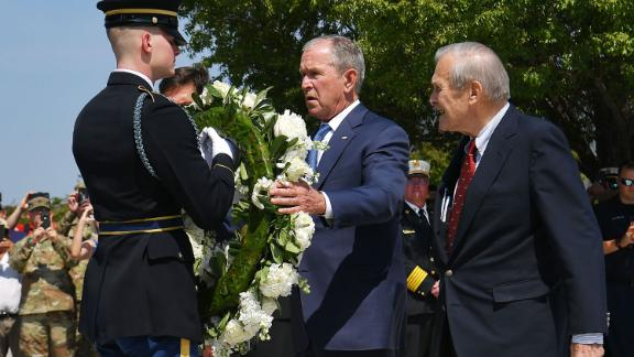 Rumsfeld and Bush take part in a wreath-laying ceremony at the Pentagon Memorial on the September 11 anniversary in 2019.
