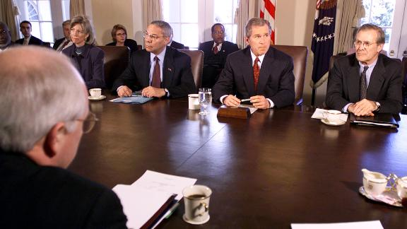 """President George W. Bush is flanked by Rumsfeld and Secretary of State Colin Powell shortly after taking office in January 2001. Rumsfeld was beginning his second stint as secretary of defense. He and Powell <a href=""""https://edition.cnn.com/2003/ALLPOLITICS/04/07/timep.reconstruction.tm/index.html"""" target=""""_blank"""">were often at odds on US foreign policy.</a>"""