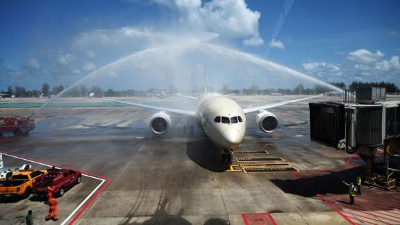 Celebratory sprays of water are splashed over an Etihad Airways airplane arriving from Abu Dhabi at Phuket International Airport on July 1, 2021.