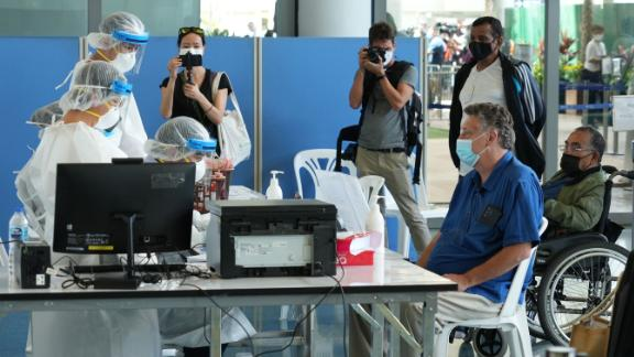 International travelers flying into Phuket must go through a series of screening checkpoints.