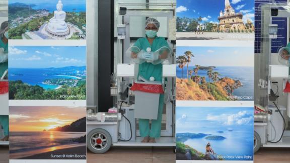 Phuket International Airport staff await incoming travelers on July 1, 2021.
