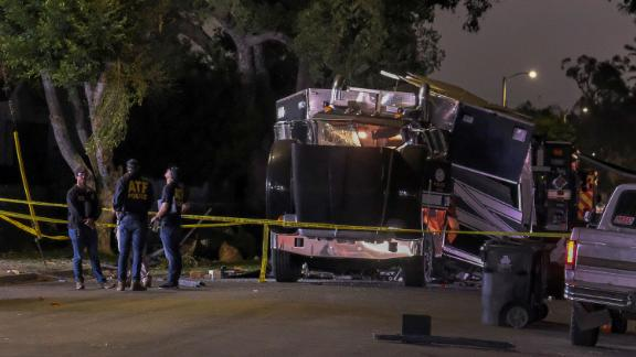 The remains of an armored Los Angeles Police Department tractor-trailer are seen after fireworks exploded Wednesday evening, June 30, 2021. A cache of illegal fireworks seized at a South Los Angeles home exploded, damaging nearby homes and cars and causing injuries, authorities said. (AP Photo/Ringo H.W. Chiu)