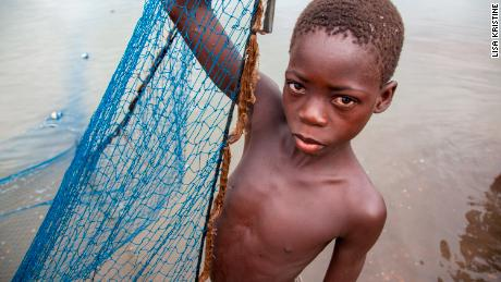 A child working on Lake Volta.