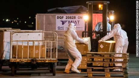 Workers unload a shipment of Sinopharm Covid-19 coronavirus vaccines in Ulaanbaatar, Mongolia in February.