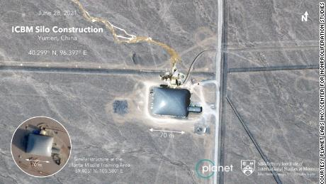 A likely single Chinese missile silo with a construction dome over the top.
