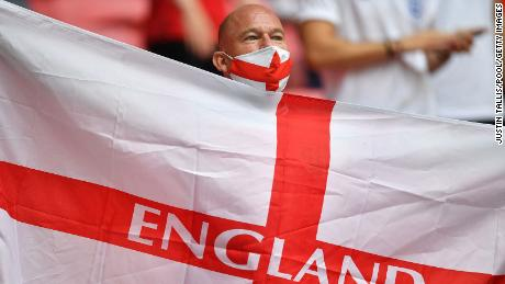 An England supporter waves a flag ahead of the start of the Euro 2020 match between England and Germany.