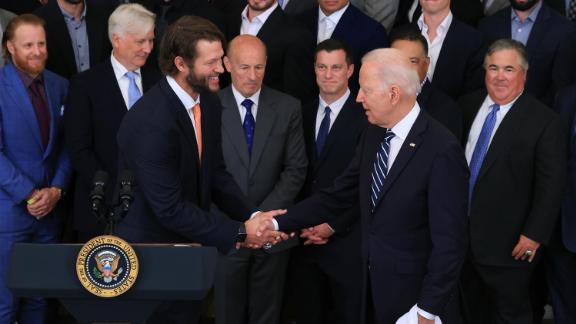 Los Angeles Dodgers pitcher Clayton Kershaw (L) shakes hands with U.S. President Joe Biden during a celebration of the team's 2020 World Series championship in the East Room of the White House on July 02, 2021 in Washington, DC.
