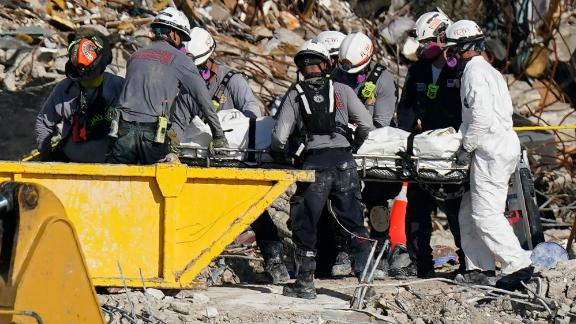 Search-and-rescue personnel work at the site on July 2.