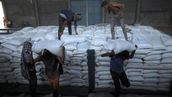 Ethiopian porters unload food aid bound for victims of war after a checkpoint leading to Tigray in Mai Tsebri town, Ethiopia June 26.
