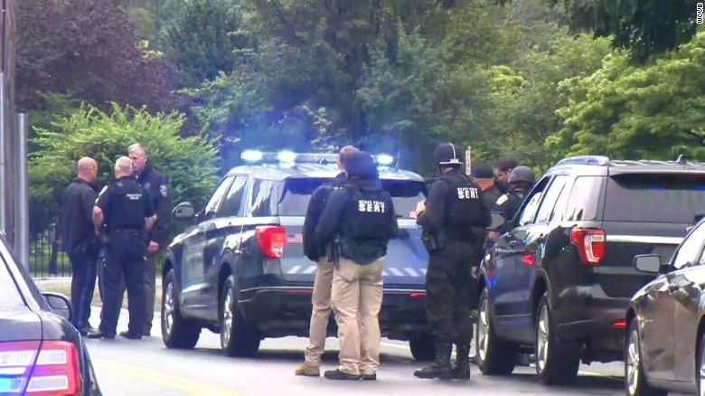 Massachusetts police standoff with heavily armed men ends in 11 arrests