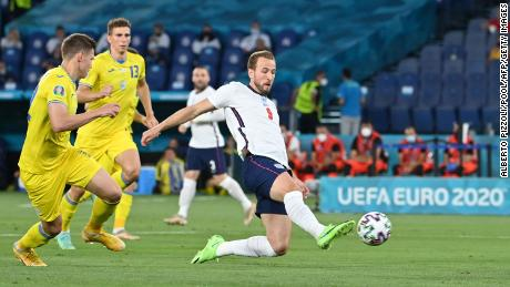 Harry Kane scores the first of his two goals against Ukraine in England's 4-0 win.