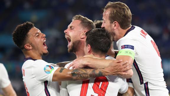 Jordan Henderson celebrates with Jadon Sancho, Mason Mount and Harry Kane after scoring England's fourth goal.