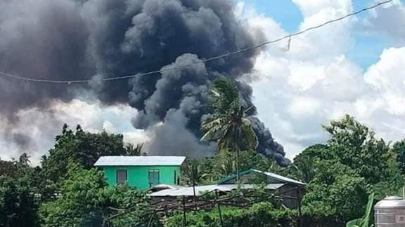 Smoke billows from the crash site in Patikul village, Jolo in the southern Philippines on July 4, 2021.