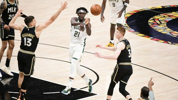 Jrue Holiday #21 of the Milwaukee Bucks passes the ball during the game against the Atlanta Hawks during Game 6 of the Eastern Conference Finals of the 2021 NBA Playoffs on July 3, 2021 at State Farm Arena in Atlanta, Georgia.