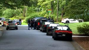Cobb County Police are looking for a suspect who shot and killed a golf pro on the green of the 10th hole of the Pinetree Country Club in Kennesaw, Georgia on Saturday afternoon. The suspect drove up to the green in a white Ram 3500 Pick-up track, according to eyewitness accounts, and shot 41 year-old pro-golfer Gene Siller.
