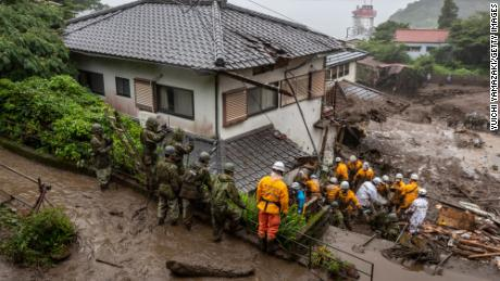 Rescue workers search for missing people at the site of a landslide on July 4, 2021 in Atami, Shizuoka, Japan.