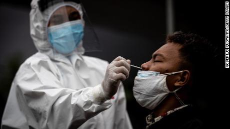 Medical staff take a Covid-19 swab antigen test in Surabaya, Indonesia, on July 3.