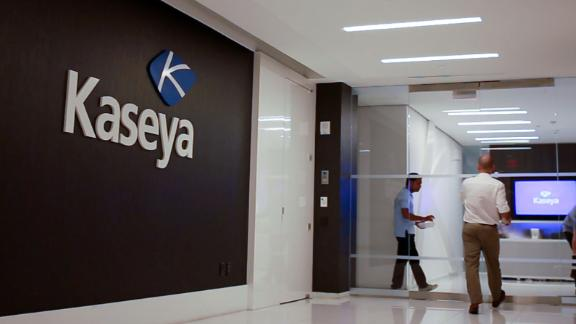 Staff enter the headquarters of information technology firm Kaseya in Miami, Florida, U.S., in an undated still image from video. Kaseya/Handout via REUTERS NO RESALES. NO ARCHIVES. THIS IMAGE HAS BEEN SUPPLIED BY A THIRD PARTY.