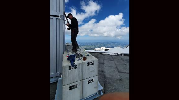 High winds at the summit of Säntis mean concrete blocks weighing a total of 18 tons are needed to anchor the laser machinery, housed inside a custom-sized shipping container.