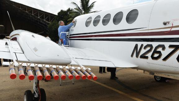 This kind of cloud charging could eventually be combined with cloud seeding -- an existing technology where planes inject particles into clouds to encourage rain. Pictured, an aircraft fitted with canisters of cloud seeding silver iodide, sodium chloride and potassium chloride at Jakkur Airport in the Indian city of Bangalore, in August 2017.