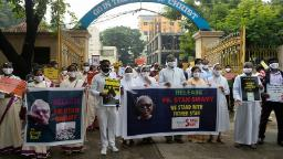 Catholic priests and nuns hold placards during a protest against the arrest of Jesuit priest Father Stan Swamy in the eastern Indian state of Jharkhand for his alleged involvement in the Bhima Koregao-Elgar Parishad case, in Secunderabad the twin city of Hyderabad on October 21, 2020 (Photo by NOAH SEELAM / AFP) (Photo by NOAH SEELAM/AFP via Getty Images)