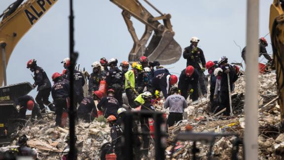 Crews work at the site of the collapsed building on July 6.