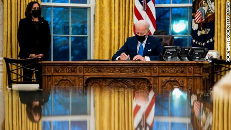 President Joe Biden signs several executive orders on immigration on February 2 in the Oval Office.