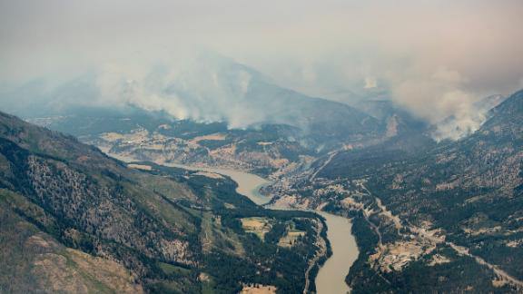 An aerial photo taken from a helicopter shows a wildfire burning in the mountains north of Lytton, British Columbia, on Thursday, July 1, 2021. (Darryl Dyck/The Canadian Press via AP)