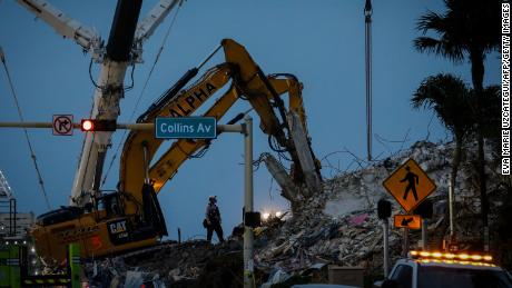 Search and rescue teams continue to work in the rubble at the site of the collapsed Champlain Towers South condo in Surfside.
