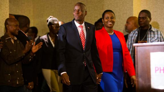 President-elect Jovenel Moise arrives with his wife Martine during his first press conference after the announcement of his victory in Petion-Ville, Haiti, Tuesday, Jan. 3, 2017. Moise, a businessman from northern Haiti who has never held political office, was certified as the official winner of the November presidential election Tuesday following a ruling by an electoral tribunal that found no evidence of large-scale voter fraud. (AP Photo/Dieu Nalio Chery)