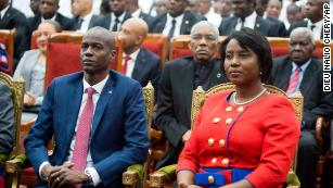 Moise sits with his wife Martine during his swearing-in ceremony in Port-au-Prince, Haiti, on February 7, 2017.