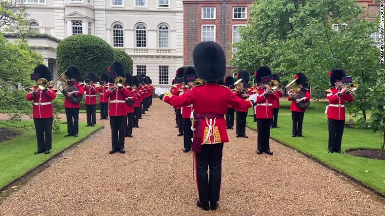 Coldstream Guards play England football anthems on Prince Charles' lawn