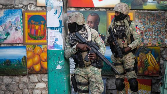 Soldiers patrol in Petion Ville, the neighborhood where the late Haitian President Jovenel Moise lived in Port-au-Prince, Haiti, Wednesday, July 7, 2021. Moïse was assassinated in an attack on his private residence early Wednesday, and First Lady Martine Moïse was shot in the overnight attack and hospitalized, according to a statement from the country's interim prime minister. (AP Photo/Joseph Odelyn)