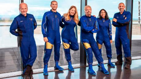 This image provided by Virgin Galactic shows Richard Branson's flight crew.